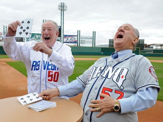 Las Vegas Mayor Oscar Goodman, left, celebrates as he draws a higher card than Reno Mayor Bob Cashell at Aces Ballpark on Monday, October 5, 2009.