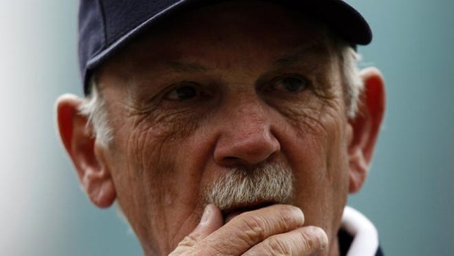 Detroit Tigers manager Jim Leyland rubs his chin with his just received American League Championship during ceremonies before their game against the Toronto Blue Jays on Wednesday April 4, 2007.