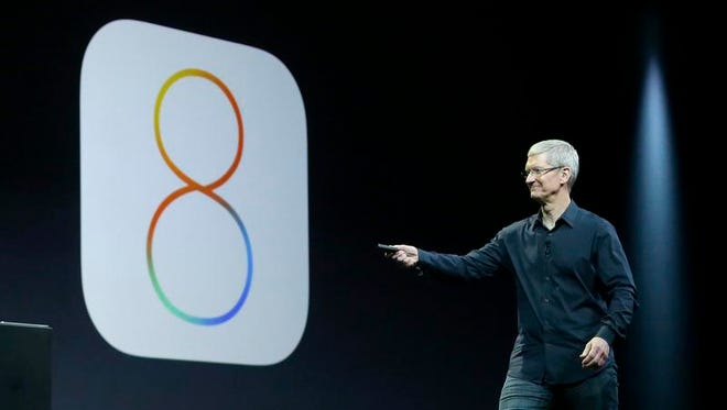 Apple CEO Tim Cook speaks about iOS 8 at the Apple Worldwide Developers Conference last week in San Francisco.