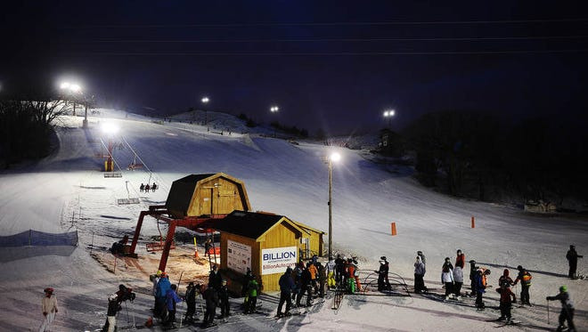 Skiers and snowboarders wait in line for the lift during the MediaOne Funski event at Great Bear Recreation Park in Sioux Falls on Friday, Jan. 24, 2014.