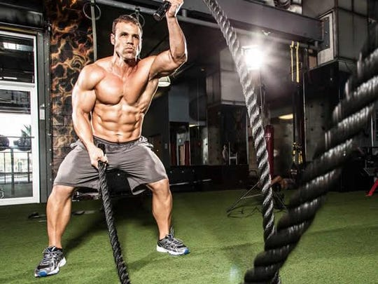 """Chad Moeller, a 1994 graduate of Sevastopol High School now living in Reedsburg, works out with battle ropes at Tampa Bay Powerhouse Gym in Florida. Moeller wrote a chapter, """"The Mission of Mindset,"""" for a new bestselling book, """"Health and Wellness Today."""""""