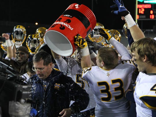 Moeller football coach John Rodenberg gets drenched