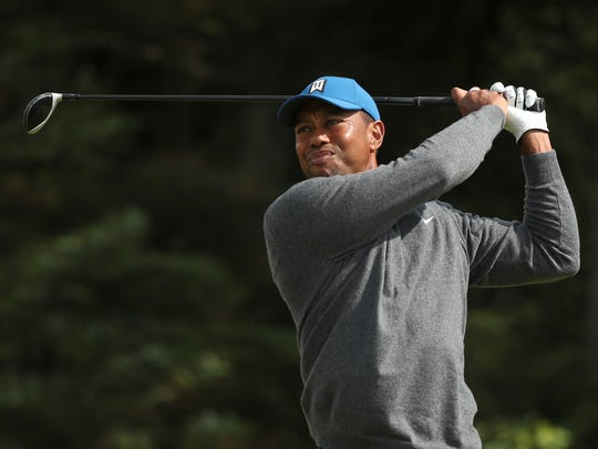Tiger Woods of the United States plays his tee shot on the 5th hole during the first round of the British Open Golf Championships at Royal Portrush in Northern Ireland, Thursday, July 18, 2019.(AP Photo/Jon Super)