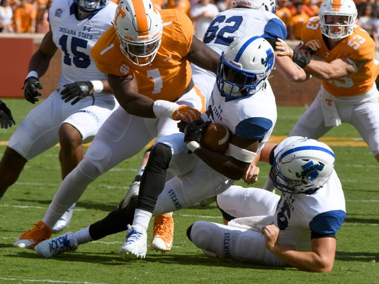Tennessee defensive lineman Jonathan Kongbo (1) tackles Indiana State running back Lemonte Booker (6) during first half action Saturday, Sep. 9, 2017 at Neyland Stadium in Knoxville, Tenn.