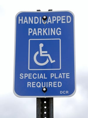 In this Monday, Sept. 28, 2015 photo, a handicapped parking sign marks a parking spot .