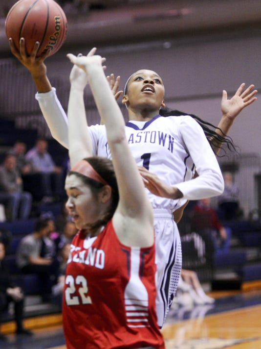 Dallastown's Amari Johnson shoots against Red Land's Rileigh Devine in District 3 Class AAAA girls' basketball playoff action.