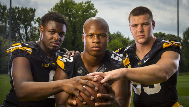 """""""It just takes time getting that chemistry going,"""" Iowa linebacker Quinton Alston, center, said of a new-look unit for the Hawkeyes this season that could also include Reggie Spearman, left, and Travis Perry, right. """"We're all close friends off the field and I think that's going to translate on to the field."""""""