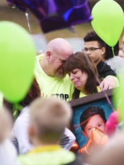 Tammy and Chad Bleakney embrace during a vigil and balloon release in memory of their son Coby at LifeWay Church in South Zanesville.