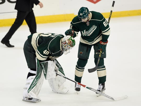 Devan Dubnyk #40 and Kurtis Gabriel #63 of the Minnesota Wild react to a loss against the Dallas Stars of Game Six of the Western Conference First Round during the 2016 NHL Stanley Cup Playoffs on Monday at Xcel Energy Center in St Paul. The Stars defeated the Wild 5-4.