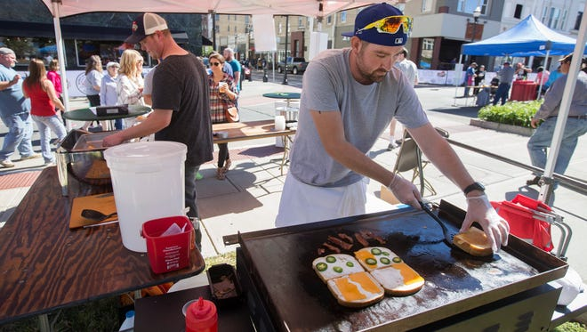 Chris Buterbaugh, the kitchen manager at Druff's, prepares a pair of grilled cheese sandwiches at the Taste of SOMO last October. The festival is moving to June.