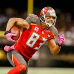 Tampa Bay Buccaneers wide receiver Vincent Jackson (83) runs after a catch against the New Orleans Saints during the third quarter of a game at Mercedes-Benz Superdome.
