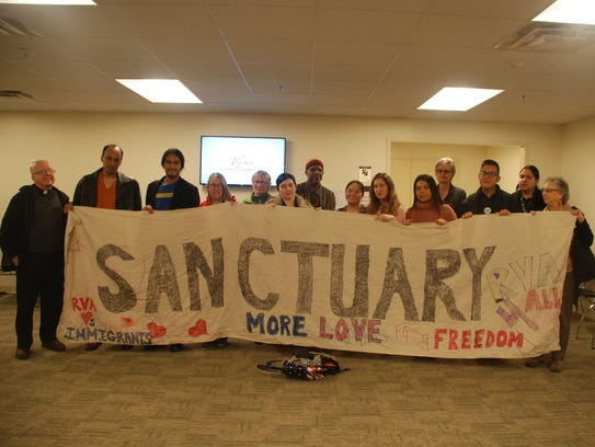 Representatives from pro-sanctuary city groups, including