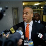 Newark Mayor and Senate candidate Cory Booker answers a question after voting in a Democratic primary election Aug. 13.