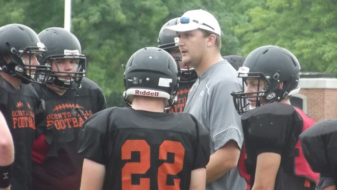 Oconto Falls coach Barry Derickson talks with his team during a scrimmage at Green Bay East on Friday. Derickson is entering his first year as the team's head coach.