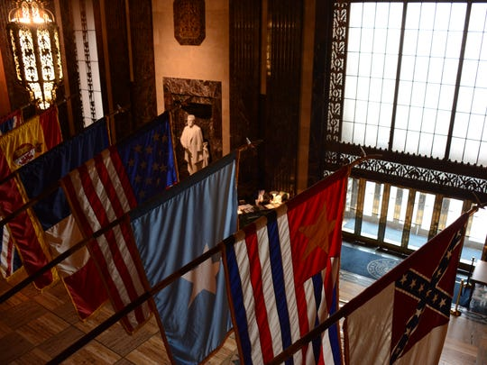 In the Capitol rotunda, otherwise knows as Memorial Hall, hang the 10 flags that have flown over Louisiana in its history.