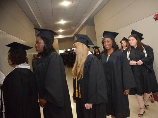 Central Louisiana Technical Community College graduates line up to walk in the processional of spring commencement Friday at the Alexandria Riverfront Center.