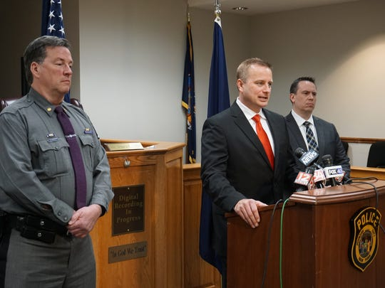 Broome County District Attorney Steve Cornwell, center,
