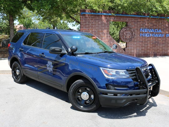"""A side view of a Nevada Highway Patrol vehicle outfitted in the new """"ghost"""" markings, which are more difficult to identify."""