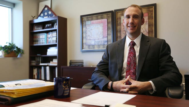 Chad Jensen, new chief juvenile court officer for the Fifth Judicial District, sits at his desk on Tuesday, Nov. 25, 2014 at the Polk County River Place office building. Jensen has been the court officer since late October.