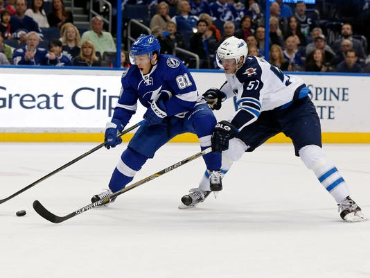 Tampa Bay Lightning's Jonathan Marchessault avoids the check of Winnipeg Jets' Tyler Myers during the second period of an NHL hockey game Thursday, Feb. 18, 2016, in Tampa, Fla. (AP Photo/Mike Carlson)