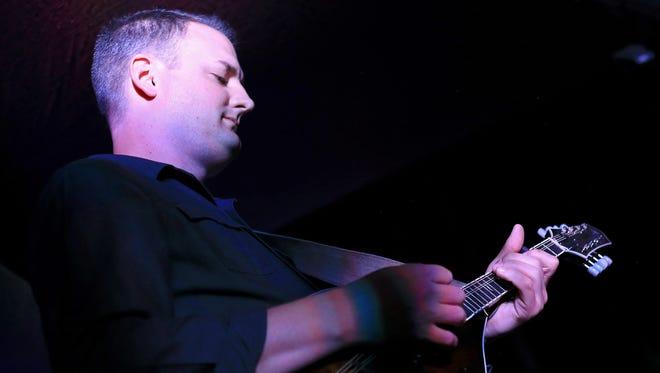 Ryan Tilby plays the mandolin with David Jorgensen as they perform at The Granary in Santa Clara.