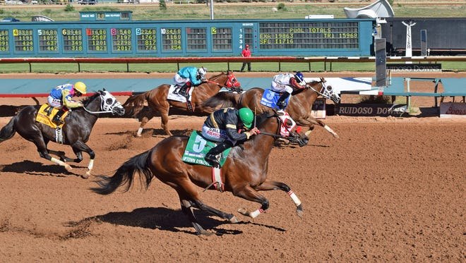 Eagle Jazz #3 and Uptown Dynasty (#5) are in a dead heat in the Ruidoso Futurity Sunday.