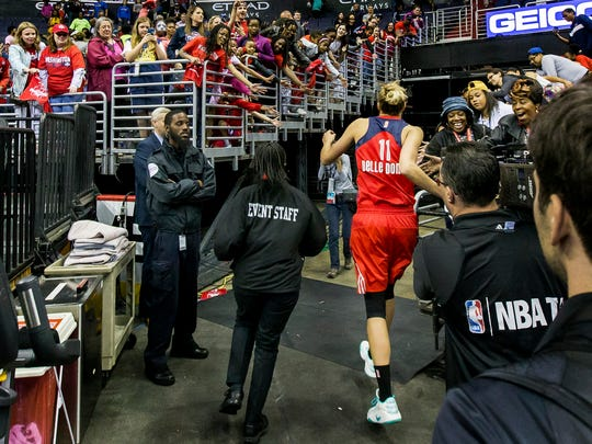 Washington's Elena Delle Donne runs through fans with outstretched hands on her way back to the locker room following the Washington Mystics' 89-74 win over the San Antonio Stars at the Verizon Center in Washington, D.C. on Sunday afternoon.
