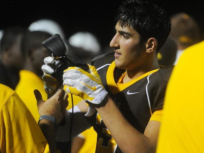 Senior Sasoun Tcholakian caught two touchdown passes Friday in the 26-21 victory.