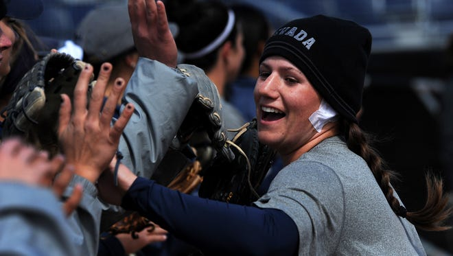 Nevada sophomore Jennifer Purcell high fives her teammates during practice Tuesday. She tied the NCAA record for consecutive at-bats with a high (13) last weekend.