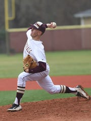 Arlington's Mike Pascoe throws a pitch during a May