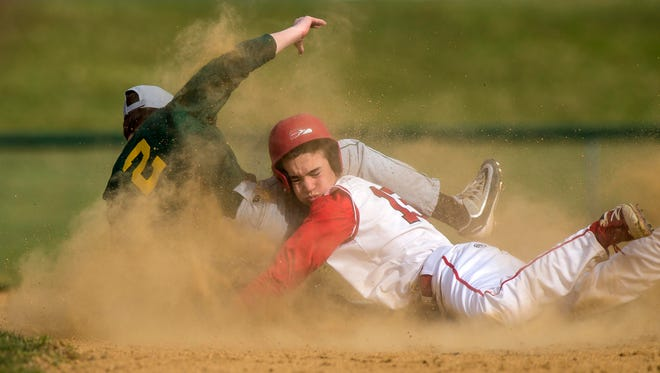 Champlain Valley Union's Jonah Roberts, right, collides at second base with Bellows Free Academy's Jake Hall in Hinesburg on Tuesday, April 24, 2018.