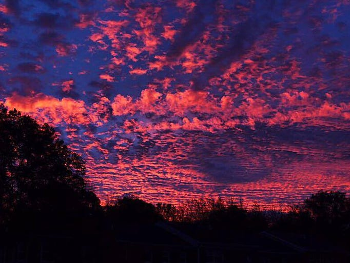 A spectacular sunrise colors the skies over Alexandria,