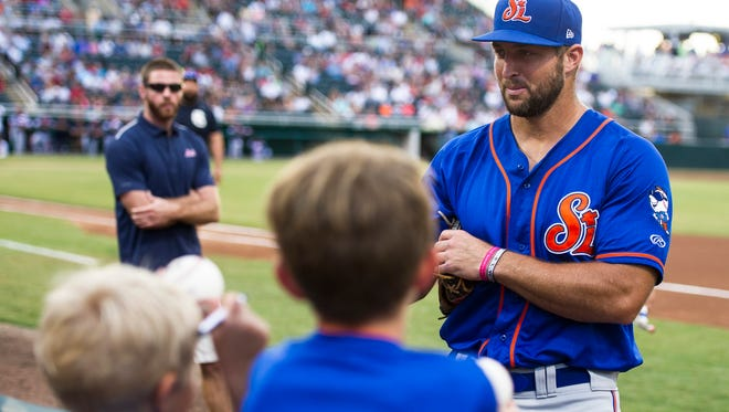 Tim Tebow signs memorabilia before a Fort Myers Miracle game at Hammond Stadium in Fort Myers, Fla., on July 3, 2017.