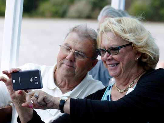 """Merlin """"Lars"""" and Liz Mercer Larsen, of Denver, Colo., take a selfie while on the Skyline Princess boat tour on Friday, July 8. Lars, a submarine veteran of USS Carp SS 338 from 66' to 68', and his wife visited Manitowoc for a USS Carp reunion."""