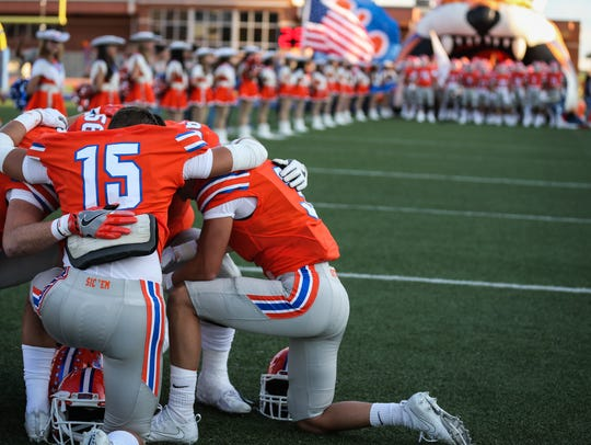 Central's captains huddle before joining the rest of