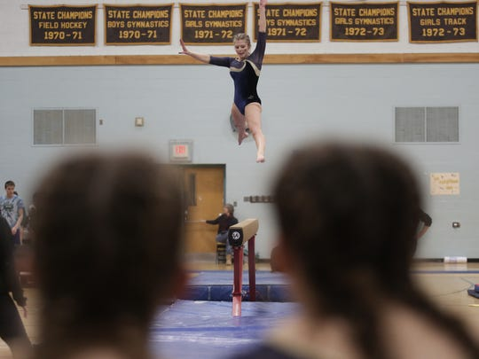 Essex's Anna Charland competes on beam during Saturday's Vermont state gymnastics championships at Essex High School.