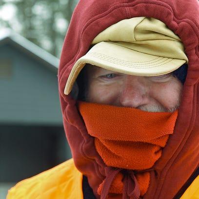 Joe Carolin, Fayetteville, is bundled up to protect