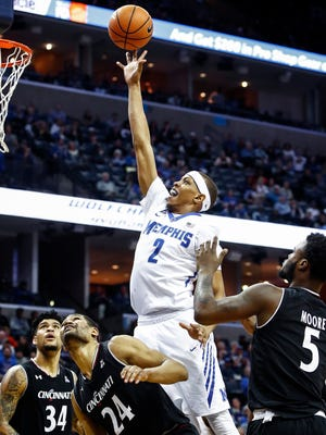 Memphis forward Jimario Rivers puts up a shot against the Cincinnati defense during the second half Saturday at FedExForum.
