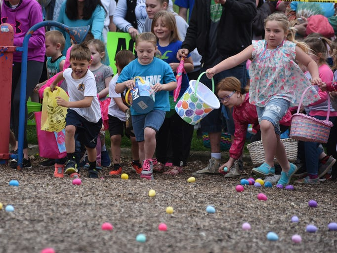 Kids race onto the playground for the Easter egg hunt