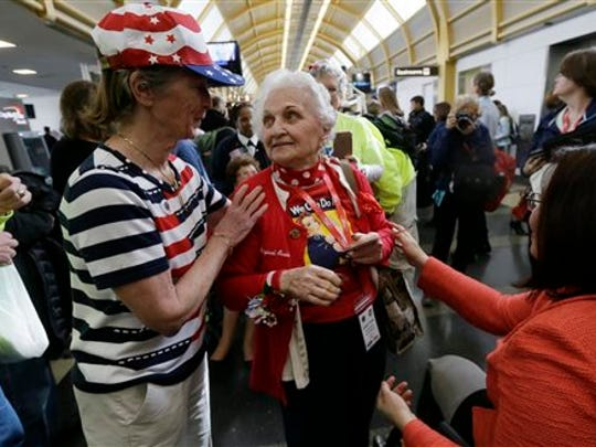 Former Rosie, Sylvia Tanis is greeted after her arrival at the Ronald Reagan Washington National Airport, Tuesday, March 22, 2016 in Washington.