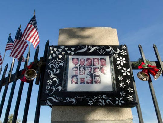 A photo collage showing images of the 14 victims who