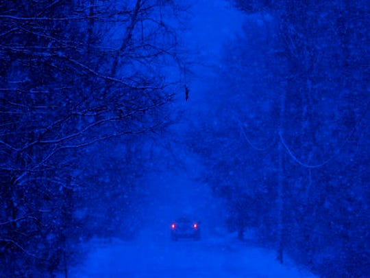 A motorist drives through a snow storm in Durham, Maine, Thursday, Dec. 29, 2016. A nor'easter is expected to drop 12 to 18 inches of snow on parts of Maine, according to the National Weather Service.