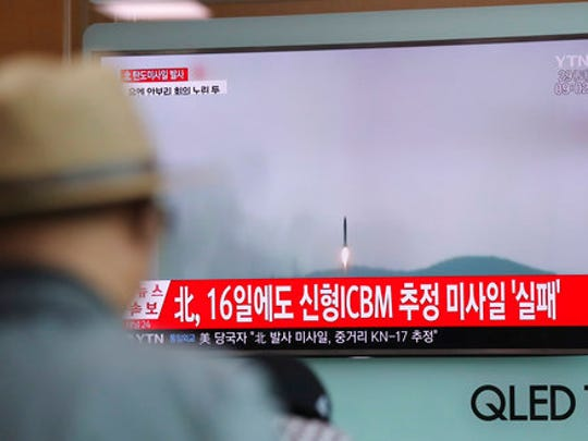 "A man watches a TV news program reporting about North Korea's missile firing with a file footage, at Seoul Train Station in Seoul, South Korea, Saturday, April 29, 2017. A North Korean mid-range ballistic missile apparently failed shortly after launch Saturday, South Korea and the United States said, the second such test-fire flop in recent weeks but a clear message of defiance as a U.S. supercarrier conducts drills in nearby waters. The letters on top left, reading ""North Korea fired a ballistic missile."""