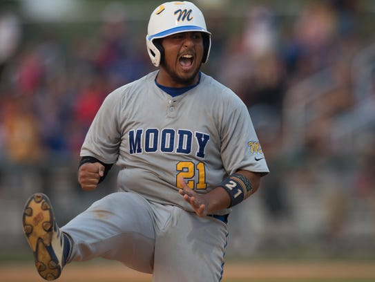 Moody's Ramsey Flores cheers after running to third