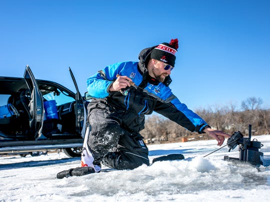 Ice Team Member Boomer Stelmach dials in his Vexilar flasher while beginning his day fishing catfish on Horseshoe Lake. Stelmach and a number of anglers caught their first channel catfish through the ice.