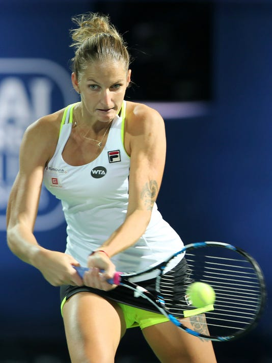 Karolina Pliskova from Czech returns the ball to CoCo Vandeweghe from the U.S. during the first day of the Dubai Tennis Championships in Dubai, United Arab Emirates, Monday, Feb. 15, 2016. (AP Photo/Kamran Jebreili)