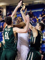 Delaware forward Marvin King-Davis is stymied by William and Mary's Jack Whitman (left) and Greg Malinowski in the second half of Delaware's 94-79 loss at the Bob Carpenter Center Thursday.