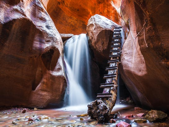 At the waterfall, there was a ladder made out of a