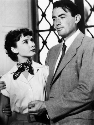 "Audrey Hepburn and Gregory Peck star in the romance ""Roman Holiday."""