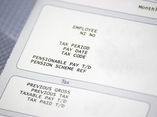 Paper pay slip with tax and pension information
